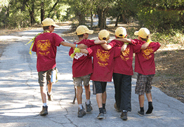 cub scout custom t-shirts boys in a cub scout pack walking down road