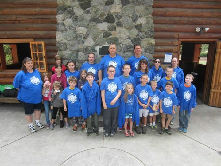 Cub Scout Pack 4537 is shown wearing royal blue Class B uniforms on a campout in Washington State.