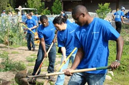 youth doing a service project wearing t-shirts