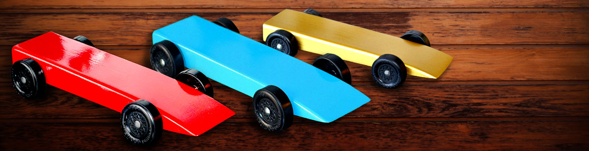 Cub Scout pack pinewood derby planning guide header image showing a pinewood derby in background with derbies made easy ebook in front