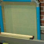 Emulsion being applied to screen print screen