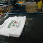 Green ink application and the curing processor the t-shirts